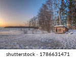A Small Hut On The Shores Of A...