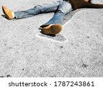 Man lying in dead man chalk...