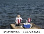 Man Fishing On A Lake Or River...