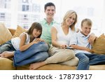 family sitting in living room... | Shutterstock . vector #17873917