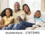 family sitting in living room...   Shutterstock . vector #17873983