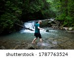 young guy stands by the river... | Shutterstock . vector #1787763524