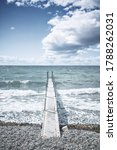 Small Pier At A Cold Sea With...