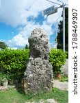 Small photo of Nintouzeiseki or Poll Tax stone at Miyako island, Okinawa. A poll tax was levied to the person who is taller than this stone.