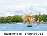 Admiralty, Admiralty embankment and pier, tourists and vacationers on the city street. Summer view of the downtown of Saint Petersburg from the Neva river