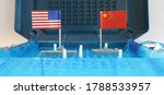 Small photo of A battleship game board featuring a US navy warship and a Chinese naval ship with national flags. South China sea news and international waters navigation conflict confrontation concept