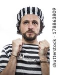 Small photo of Incarcerated, Desperate, portrait of a man prisoner in prison garb, over white background