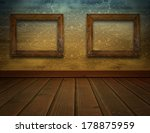 room with brown damask wallpaper and ornate empty picture frame - stock photo