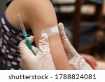 Small photo of Doctor vaccinated in shoulder. Promotion disease prevention. Medical syringe with vaccine. Accidental injection. Fight against diseases, vaccine against covid 19. Injection from coronavirus concept.