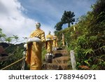 Buddha Statue On The Stairs Is...