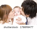 Japanese Parents Kissing Baby