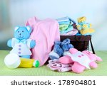 Pile Of Baby Clothes  In Baske...