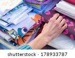 female hand  rummaging among... | Shutterstock . vector #178933787