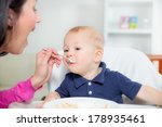 mother feeding hungry baby in... | Shutterstock . vector #178935461