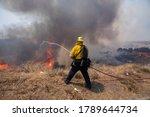 Firefighter Battling Brushfire...