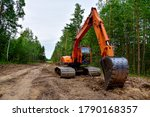 Excavator Clearing Forest For...