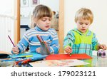 serious children sketching with ... | Shutterstock . vector #179023121