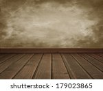 Grunge wall with wooden  floor - stock photo