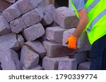 Worker Build A Dry Stone Wall...