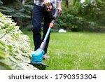 Gardening. Cutting The Lawn...