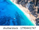 Aerial view of the beautiful coast of Kefalonia island, Greece, with turquoise sea, little beaches and a sailboat moored over the crystal clean water - stock photo
