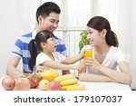 happy family making juice with ... | Shutterstock . vector #179107037