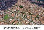 Small photo of serveral houses ordained on a circle pattern with some trees on it