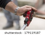 plumber cutting a copper pipe... | Shutterstock . vector #179119187