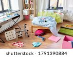 mess, disorder and interior concept - view of messy home kid