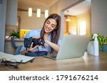 Woman Working On Laptop In Home....