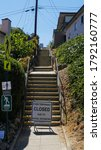 Small photo of La Mesa, California - August 7, 2020: The City of La Mesa has several sets of public stairways. All stairs are closed until further notice due to noncompliance with mask and distancing regulations.