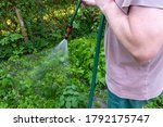 Watering The Garden With A...