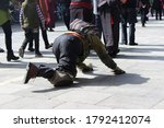 Small photo of Buddhist believers kowtow in three steps in Lhasa, Tibet, China-24 May 2015