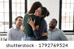 Small photo of Smiling Indian psychologist hugging patient at group counselling session, giving psychological help, expressing support and empathy, helping overcome problems, depressing or addictions treatment