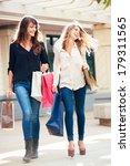 two happy young women shopping... | Shutterstock . vector #179311565