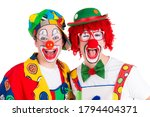 Two Funny Clowns With Red Noses