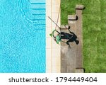 Professional Caucasian Gardener in His 40s Finishing Lawn Around Swimming Pool Installing New Grass Turfs. Landscaping Industry Theme. - stock photo