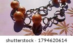 Orange Round Beads With A Chain ...