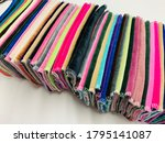 Small photo of Rainbow Textiles and Soft Fabrics in a stagger