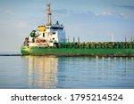 Large Green Cargo Ship Sailing...