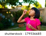 young asian girl blowing... | Shutterstock . vector #179536685
