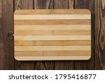 A Wooden Cutting Board With A...