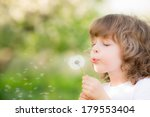 Happy Child Blowing Dandelion...