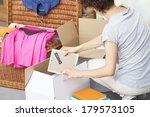 a woman packing picture frames... | Shutterstock . vector #179573105