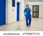 A Cleaning Lady With A Mask On...