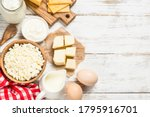 Dairy Product At White Wooden...