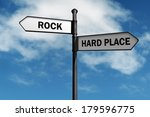 Crossroad Signpost Saying Rock...