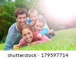portrait of happy family laying ...   Shutterstock . vector #179597714
