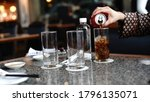 pouring water in to glass   Shutterstock . vector #1796135071