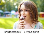 young woman with ice cream. | Shutterstock . vector #179655845